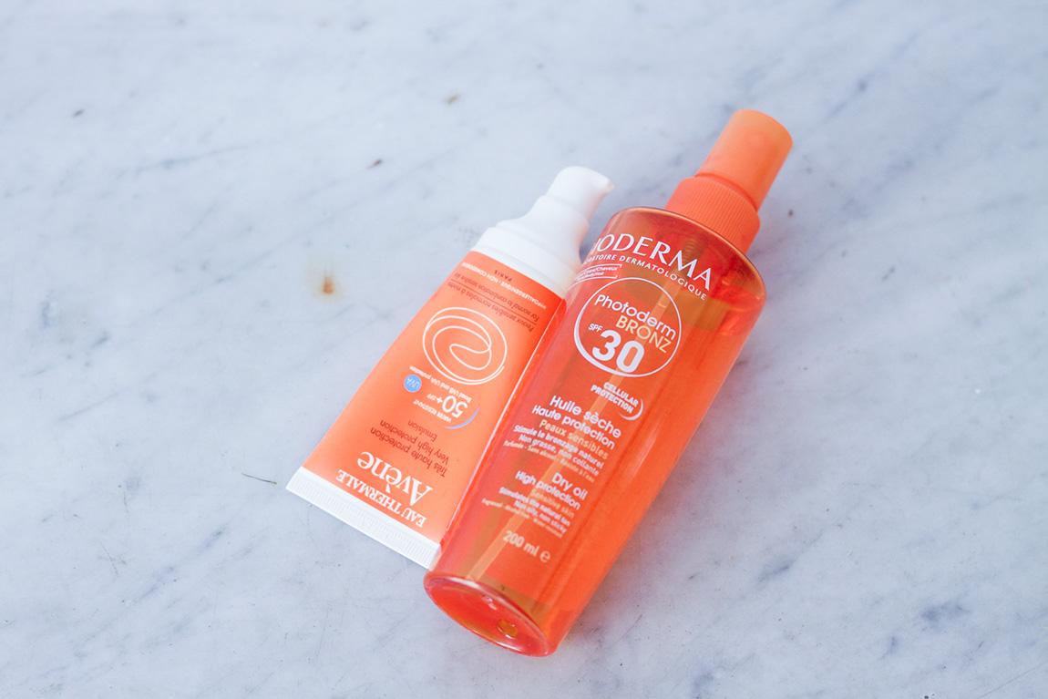 Huile sèche solaire Bioderma indice 30 et crème Avène peau sensible indice 50